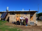 A Kyrgyz family in from of their house with Eco-loo and Solar Collector